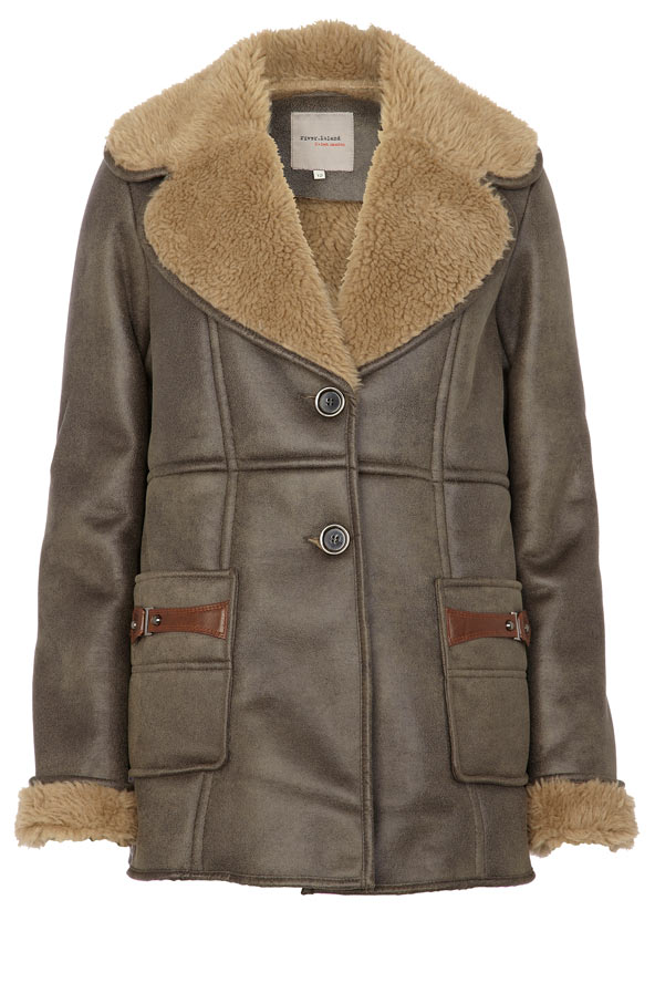 Keep your pet warm and protected from winter's blustery weather with this stylish, faux suede coat. It has a soft polyester fleece lining that looks like real sheepskin and an adjustable belly belt with easy
