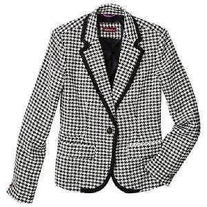 Houndstooth, hounds tooth check or hound's tooth (and similar spellings), also known as dogstooth, dogtooth, dog's tooth, or pied-de-poule, is a duotone textile pattern characterized by broken checks or abstract four-pointed shapes, often in black and white, although other colours are used.