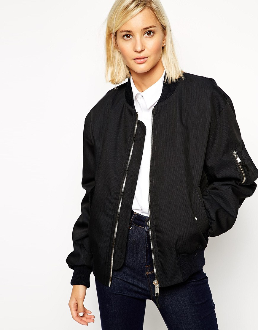 Bomber Jacket. Sleek. Lined. Hooded. Step out in style and make a lasting impression in an eye-catching bomber jacket. The bomber style offers cool, casual appeal and .